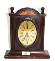 A mahogany inlaid desk timepiece, signed Waltham, USA