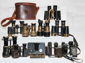 A pair of Second World War binoculars by Taylor-Hobson 1943, in leather case; nine various pairs