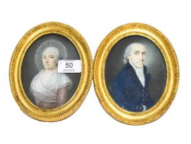 A pair of watercolour and gouache oval miniatures, possibly Russian, circa 1800, depicting a husband