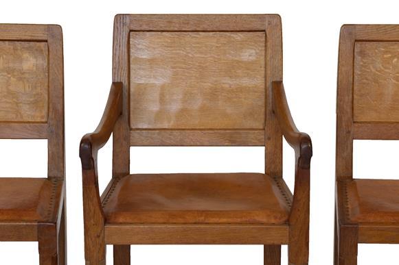 Robert Mouseman Thompson (1876-1955): A Set of Six (4+2) English Oak Panel Back Dining Chairs, - Image 2 of 5