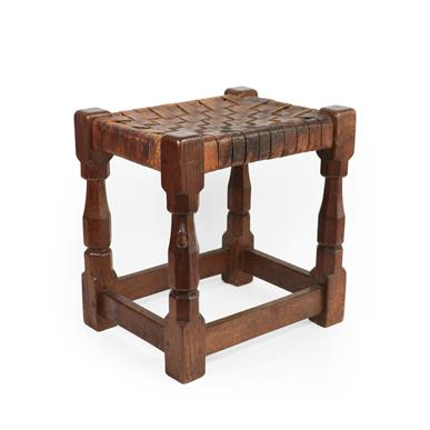 Robert Mouseman Thompson (1876-1955): An English Oak Stool, strap leather top, on four octagonal - Image 3 of 6