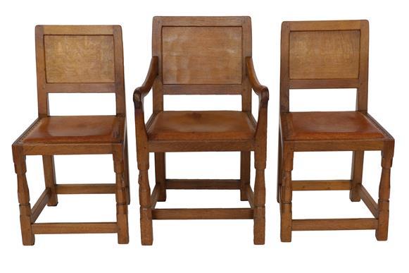 Robert Mouseman Thompson (1876-1955): A Set of Six (4+2) English Oak Panel Back Dining Chairs, - Image 4 of 5