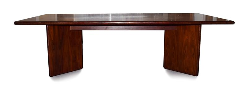 Dyrund: A Danish Rosewood Dining Table, circa 1970/80, of rectangular form, the underside stamped