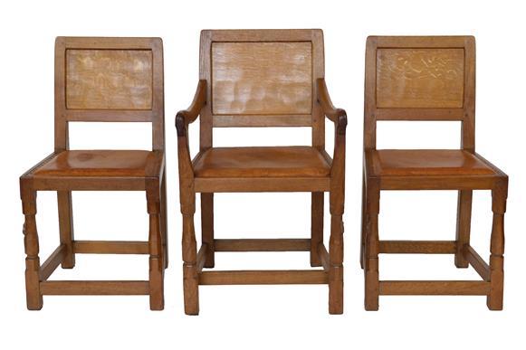 Robert Mouseman Thompson (1876-1955): A Set of Six (4+2) English Oak Panel Back Dining Chairs,