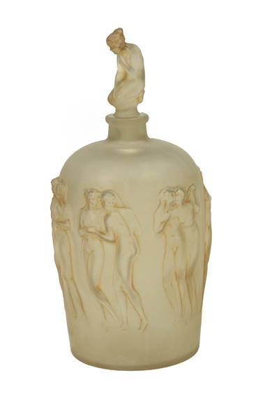 René Lalique (French, 1860-1945): A Frosted and Sepia Stained Douse Figurines Avec Bouchon