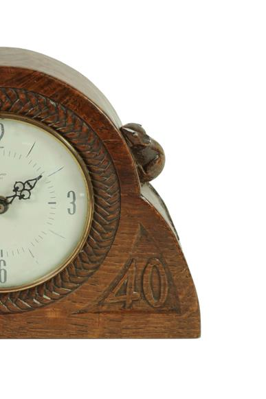 Robert Mouseman Thompson (1876-1955): An English Oak Mantel Clock, dated 1940, the face surrounded - Image 3 of 4