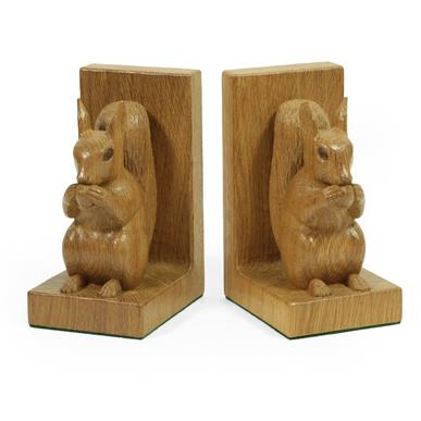 Stan Dodds (1928-2012): A Pair of English Oak Carved Red Squirrel Bookends, both sitting up on their