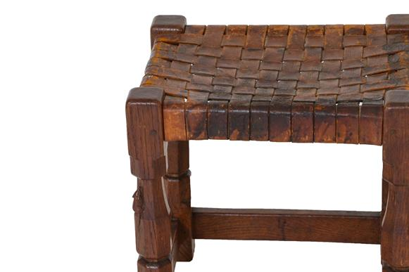 Robert Mouseman Thompson (1876-1955): An English Oak Stool, strap leather top, on four octagonal - Image 6 of 6