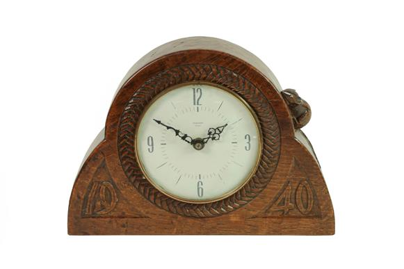 Robert Mouseman Thompson (1876-1955): An English Oak Mantel Clock, dated 1940, the face surrounded