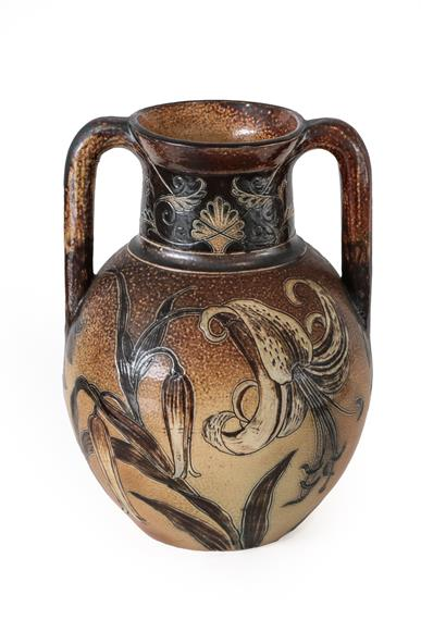 A Martin Brothers Stoneware Twin-Handled Vase, by Robert Wallace Martin, decorated with white
