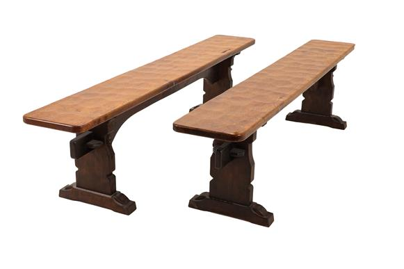 Robert Mouseman Thompson (1876-1955): A Pair of 6ft Oak Benches, on three shaped supports, joined by