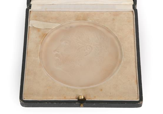 René Lalique (French, 1860-1945): A Frosted Glass Portrait Medallion, moulded with the profile of