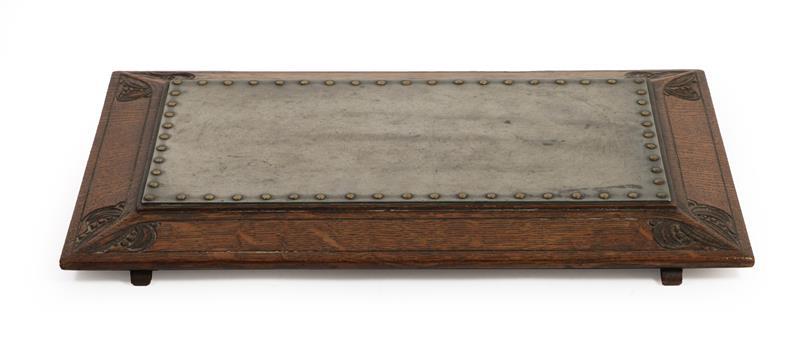 Arthur W Simpson (1857-1922) and Hubert Simpson (1889-1975) An Oak Easy Stool, with studded