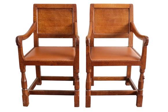 Workshop of Robert Mouseman Thompson (Kilburn): A Pair of English Oak Panel-Back Armchairs, brown