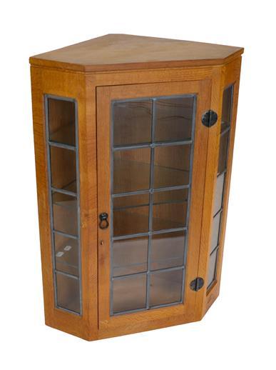 Workshop of Robert Mouseman Thompson (Kilburn): An English Oak Glazed Hanging Corner Cupboard, the