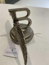 A 1930's Bentley Winged Car Mascot (a.f.), mounted on a radiator cap, 10cm high