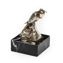 A Chrome-Plated Bird of Prey Car Mascot, standing on a rocky base, mounted on a later black marble