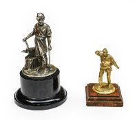 A Brass Radiator Lifeboatman Car Mascot, mounted on a stained wooden base, 9cm high; and A Vulcan