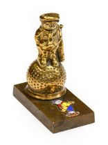 A Solid Brass Golfer Car Radiator Mascot, mounted on a rectangular base with enamelled Dunlop
