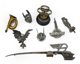 Eight Associated 1920/30 Car Mascots, to include, Wolseley, Morris, Alvis; and A Small Brass Horn (