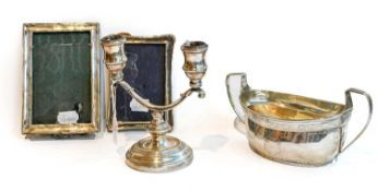A George III Irish silver sucrier; together with a silver two branch candlestick and two silver-
