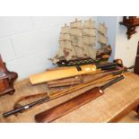 Two cricket bats one signed with a former Yorkshire team, two hickory shafted golf clubs, a lacrosse