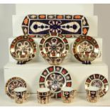 A quantity of Royal Crown Derby Imari pattern 1128 including a pair of teacups and saucers, sandwich