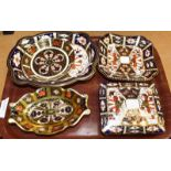 A group of five Royal Crown Derby pieces including an oblong trinket box and cover, a square dish