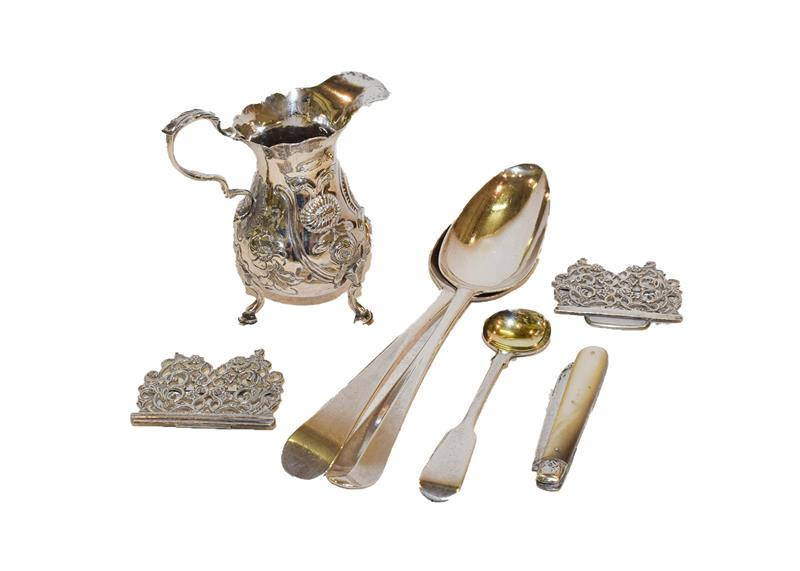 A collection of silver, including a George II silver cream jug, a nurses belt, a silver and mother