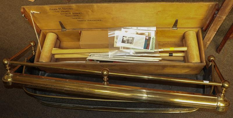 A cased croquet set together with a pierce brass fire fender and another extending brass fire fender