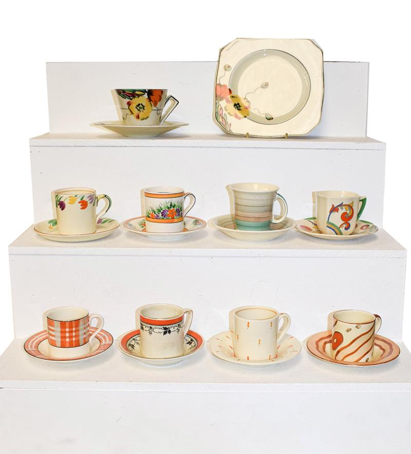 A group of Art Deco coffee cans and saucers (three trays)