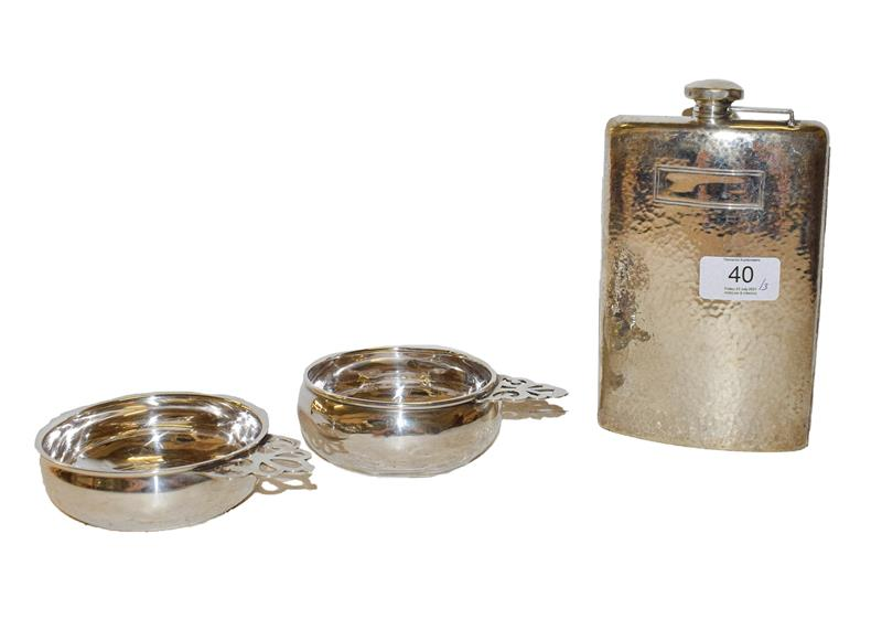 An American silver flask and two porringers, the flask by Webster Company, one porringer by Wallace,