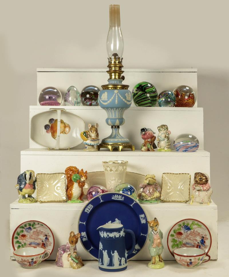 A 19th century pale blue Jasperware oil lamp, a quantity of various paperweights by Caithness and