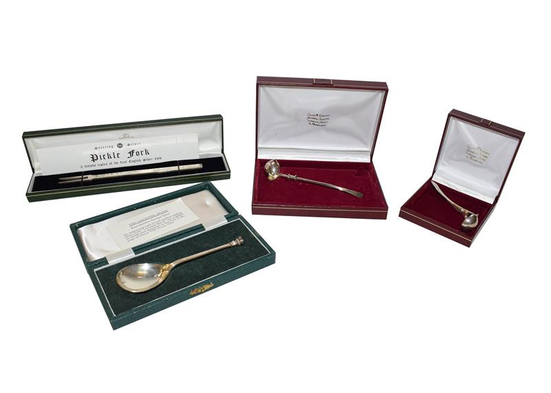 Four Iitems of Elizabeth II silver flatware including a copy of a 17th century silver fork (cased) a