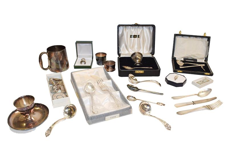 A collection of assorted silver and silver plate, the silver comprising assorted flatware, a cased