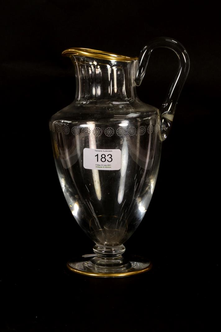 A Baccarat glass jug, with flat cut collar, etched band of daisy heads, gilt rims and a gilt