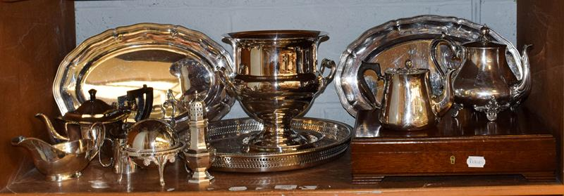 A quantity of mixed silver plated items including a pair of serving dishes, ice bucket on stand,
