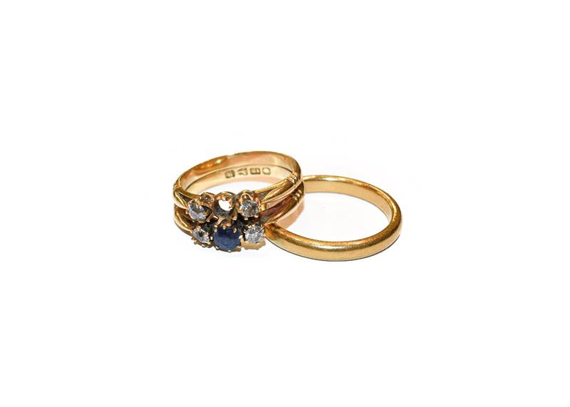 A 22 carat gold band ring, finger size R; and an 18 carat gold synthetic sapphire and diamond