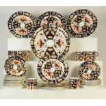 A quantity of Royal Crown Derby Old Imari including coffee cans and saucers, side plates and bread