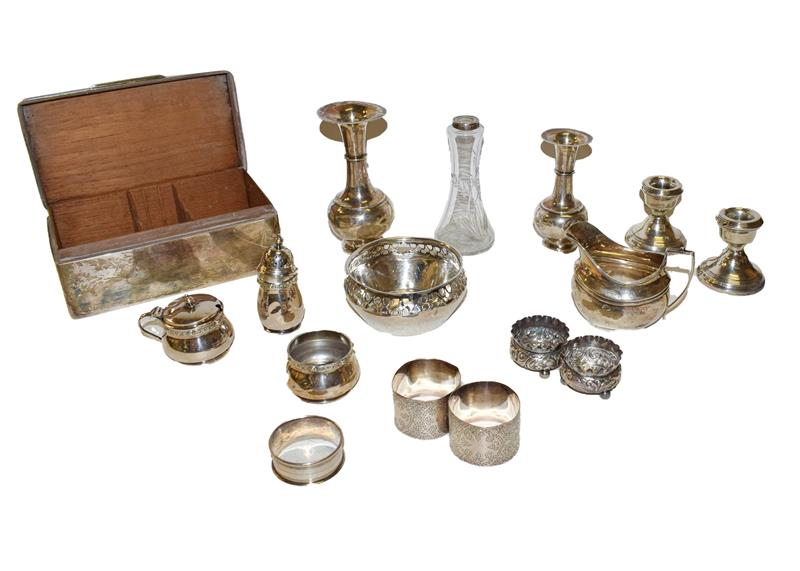 A collection of assorted silver, including a cigarette-box, a bowl with pierced border, a cream jug,