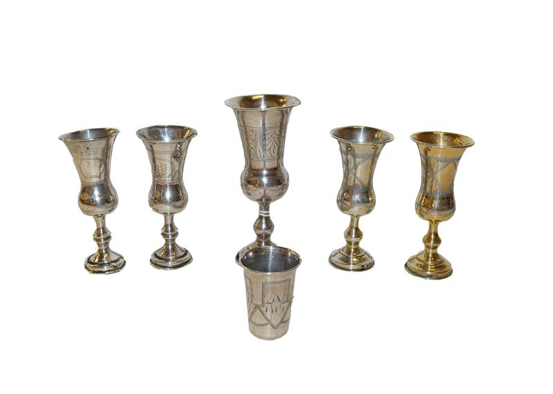 Five various Edward VII or George V silver or silver gilt Kiddush cups, each of typical form,