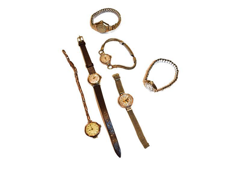 A lady's 18 carat gold Bucherer wristwatch, five lady's 9 carat gold wristwatches