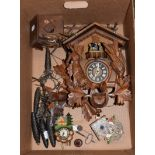 A carved and painted Black Forest cuckoo clock and three similar timepieces (one box)