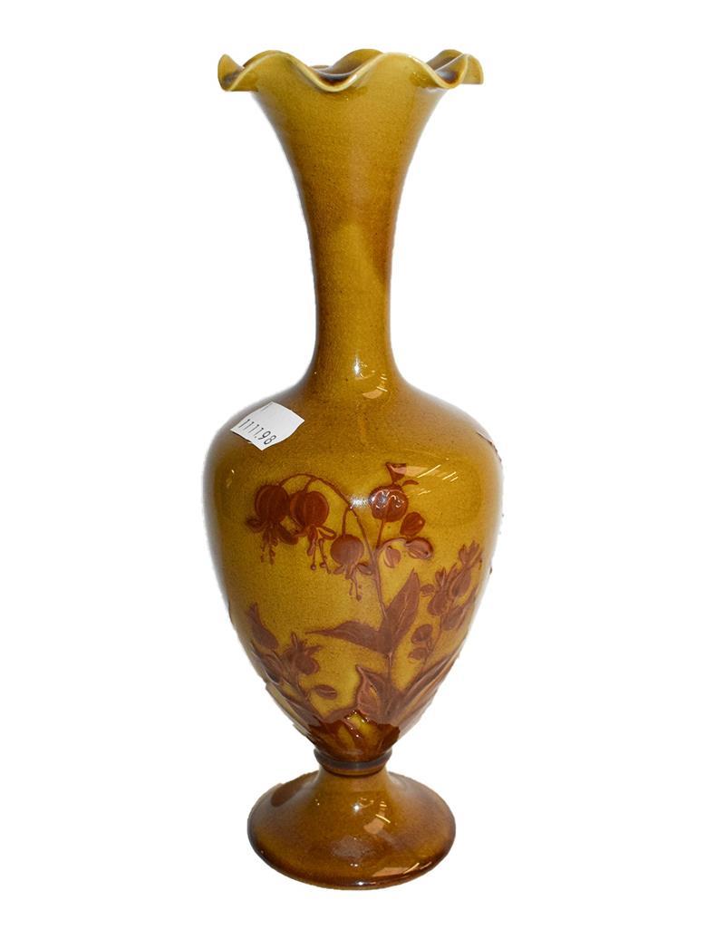 A Linthorpe mustard ground vase after a design by Christopher Dresser, 26cm