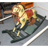 A painted dappled rocking horse on fixed base, 138cm long by 96cm high to the tip of the ears