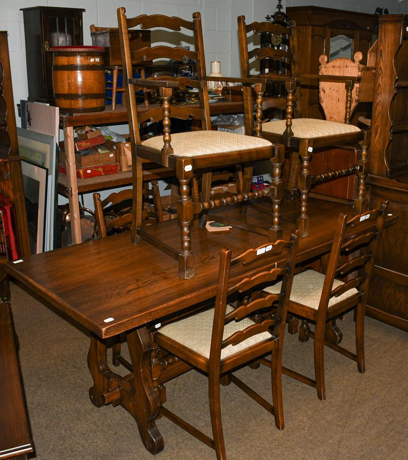 A Mellowcraft oak dining suite comprising dining table, six dining chairs, Welsh dresser and rack