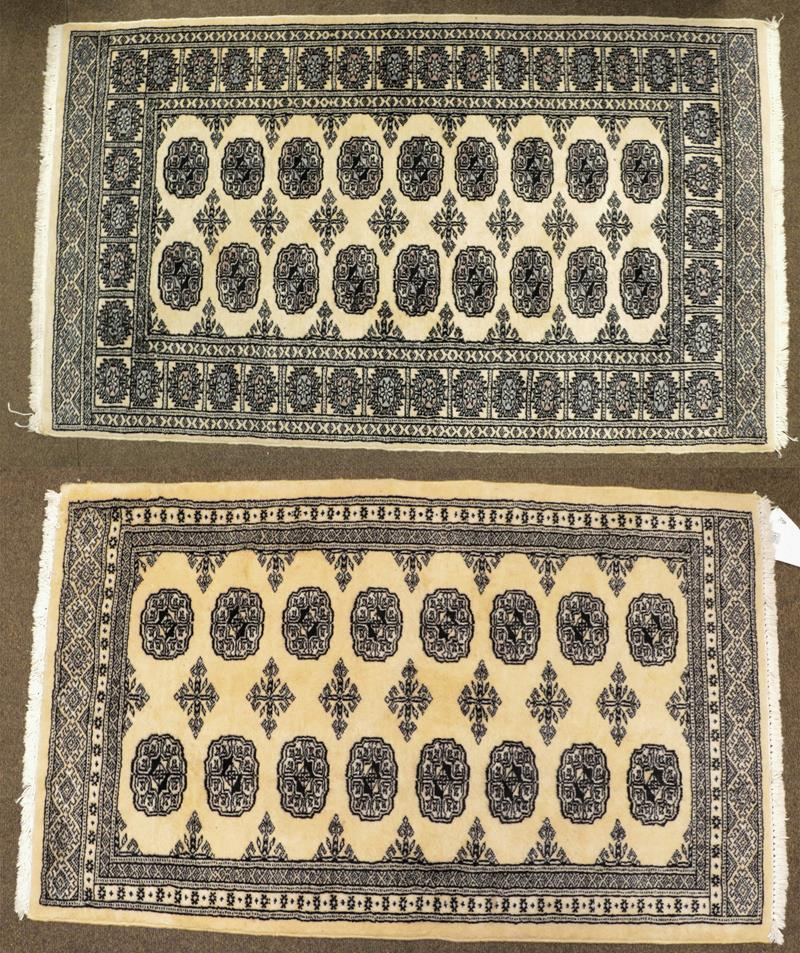 A Kashmiri 'Bukhara' Rug, the ivory field with columns of guls enclosed by narrow borders, largest