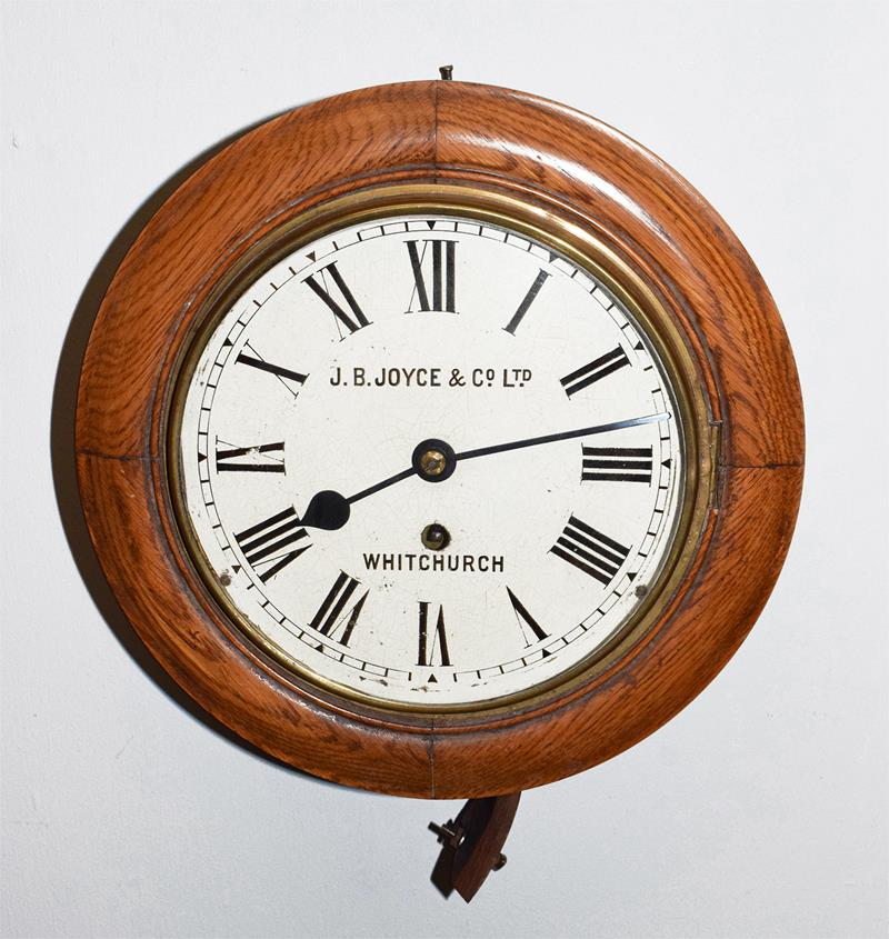 A 20th century oak cased wall timepiece, 8'' painted dial bearing later inscription J.B.Joyce & Co