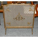 A 20th century brass spark guard, with mesh panel adorned with scrolls, 73cm by 78cm