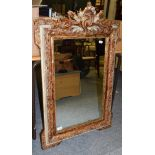 A rectangular mirror, the mildly distressed plate within a conforming leaf moulded parcel gilt frame
